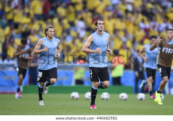 RIO, BRAZIL - June 28, 2014: Diego FORLAN and Diego GODIN of Uruguai during the FIFA 2014 World Cup. Colombia is facing Uruguay in the Round of 16 at Maracana Stadium