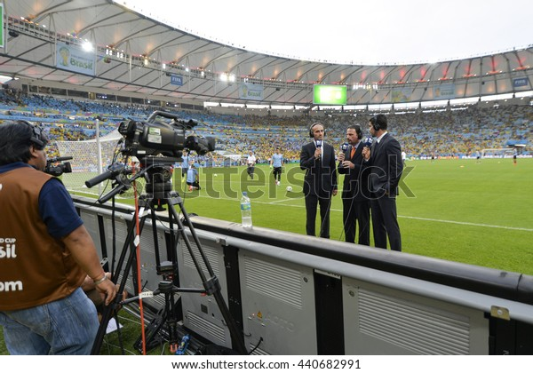 RIO, BRAZIL - June 28, 2014: TV reporters during the FIFA 2014 World Cup. Colombia is facing Uruguay in the Round of 16 at Maracana Stadium