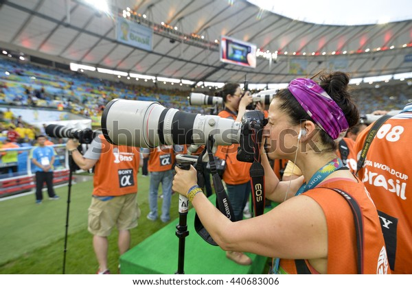 RIO, BRAZIL - June 28, 2014: Photographer with a long lens during the FIFA 2014 World Cup. Colombia is facing Uruguay in the Round of 16 at Maracana Stadium