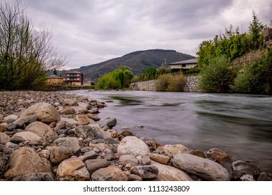 Rio Burbia and Valcarce at Villafranca del Bierzo on the Way of Saint James. In the background the El bierzo mountains.