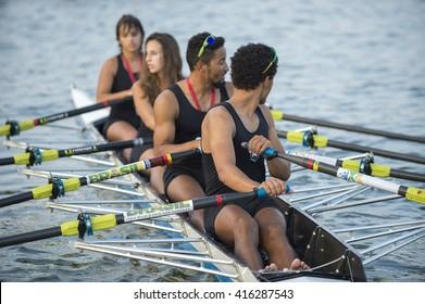 RIO DE JANEIRO - APRIL 2, 2016: A quadruple scull boat (with four rowers) prepares to compete in a race on Lagoa Rodrigo de Freitas lagoon, a venue for the Rio 2016 Olympic Games.
