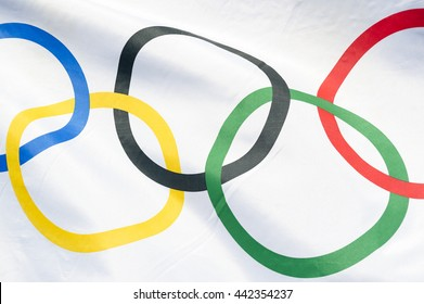 RIO DE JANEIRO - APRIL 2, 2016: An Olympic flag flutters in the wind in bright sun in anticipation of the city hosting the 2016 Summer Games.