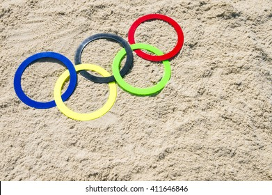 RIO DE JANEIRO - APRIL 4, 2016: Olympic rings rest in the sand on Ipanema Beach in anticipation of the city hosting the 2016 Summer Games.