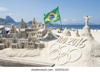 RIO DE JANEIRO - APRIL 4, 2016: Rio 2016 message made from sand topped by a model of Christ the Redeemer stands on Copacabana Beach in anticipation of the city hosting the Summer Games.