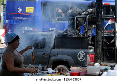Rio de Janeiro, August 14th, 2018   Brazil   Vidigal shantytown firefigths with druglords . anti riot police agents patroll the shantytown.