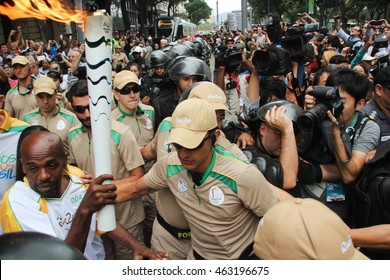 RIO DE JANEIRO, AUGUST 3, 2016: Olympic torch arrives in Cinelandia, downtown of Rio de Janeiro city, for the Olympic Games.