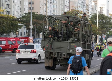 RIO DE JANEIRO - AUGUST 5: Military vehicle transporting group of armed soldiers driving downtown city during Olympics in Rio De Janeiro, Brazil on August 5, 2016.