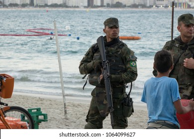 RIO DE JANEIRO - AUGUST 5 : Police officer standing guard at Copacabana beach downtown city during Olympics in Rio De Janeiro, Brazil on August 5, 2016.