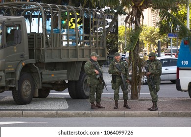 RIO DE JANEIRO - AUGUST 5: Military soldiers standing guard on city streets near beach during Olympics Summer Games in Rio De Janeiro, Brazil on August 5, 2016.