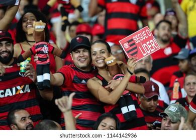 """Rio de Janeiro, Brasil, 07.18.2018 - Fan group for Flamengo team (torcida do Flamengo) during a Brazilian Championship Soccer match. Flamengo team versus Sao Paulo team. """"Segue o lider""""."""