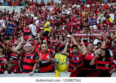 """Rio de Janeiro, Brasil, 07.29.2018 - Fan group for Flamengo team (torcida do Flamengo) during a Brazilian Championship Soccer match. Flamengo team versus Sport team. """"Segue o lider""""."""