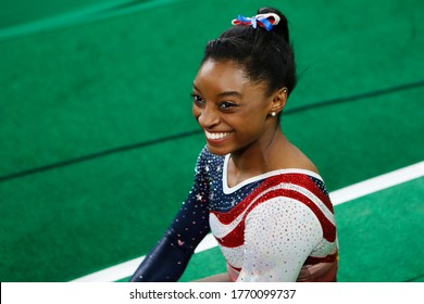 RIO DE JANEIRO, BRAZIL 08/09/2016: Simone Biles at the Rio 2016 Summer Olympic Games artistic gymnastics, smile of victory. USA athlete celebrates win of the gold medal team all-around competition