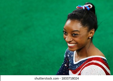 RIO DE JANEIRO, BRAZIL 08/09/2016: Simone Biles at Rio 2016 Summer Olympic Games artistic gymnastics, smile of victory. USA athlete celebrates a win of the gold medal teams, all-around competition