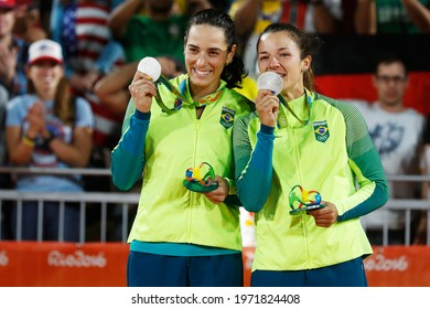 Rio de Janeiro, Brazil 08.17.2016: Ágatha Bednarczuk and Bárbara Seixas, brazilian beach volleyball silver medalist team celebrates at Rio 2016 Olympic Games podium medal ceremony.