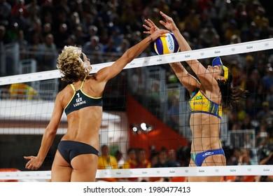 Rio de Janeiro, Brazil 08.17.2016: Laura Ludwig and Ágatha Bednarczuk, brazilian vs german beach volleyball medalist team players block at Rio 2016 Summer Olympic Games.