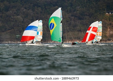 Rio de Janeiro Brazil 08.18.2016: Sailing at Rio 2016 Olympic Games. Brazilian sailors Martine Grael and Kahena Kunze win gold medal 49er FX class over France and Denmark sail boat at Guanabara bay.