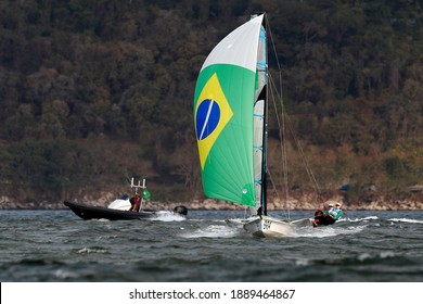 Rio de Janeiro Brazil 08.18.2016: Sailing at Rio 2016 Olympic Games. Brazilian sailors Martine Grael and Kahena Kunze win gold medal 49er FX class. Women skiff sail boat medalists at Guanabara bay.