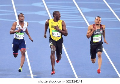 Rio De Janeiro, Brazil 15 August 2016: Jamaica's Usain Bolt smiles as he looks at Canada's Andre De Grasse, (R), during a semifinal men's 100 meters at the Olympic Summer Games in Rio de Janeiro.