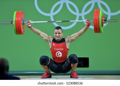 Rio De Janeiro, Brazil, 19 August 2016: Tunisia Weightlifting, Karem BenHnia, lifting in the clean and jerk category when playing at Riocentro Pavilion 2, at the Olympic Games Rio 2016, Brazil.