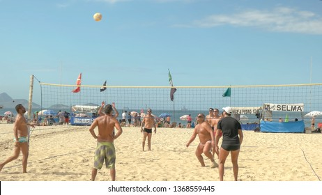 RIO DE JANEIRO, BRAZIL- 26, MAY, 2016: shot of a point being played in a volleyball game on copacabana beach in rio