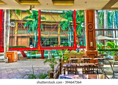 Rio de Janeiro, Brazil - Abr 25, 2015: Shopping Center Citta America indoor view pointing to the glass facade reflections of the nearby business building.
