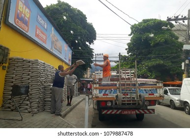 Rio de Janeiro, Brazil, April 14, 2018. Truck being loaded with sandbags at a construction material store in the west side of the city of Rio de Janeiro.