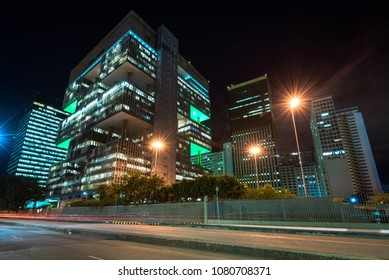 Rio de Janeiro, Brazil - April 17, 2018: Petrobras headquarters building view from the street at night. Petrobras is oil and gas industry giant in Brazil.