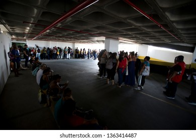 Rio de Janeiro, Brazil   April 08, 2019  Unployeds queue trying a job in a supermarket. Brazil have 13 milions of unemployed people.