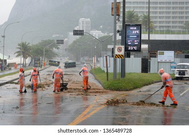 Rio de Janeiro, Brazil, April 9, 2019. City workers remove rubbish and tree branches after storm on Av Niemeyer, in the south zone of the city of Rio de Janeiro