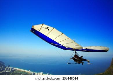 RIO DE JANEIRO, BRAZIL - APRIL 25, 2013: Brazilians and tourists enjoying hang gliding flights over Praia do Pepino.