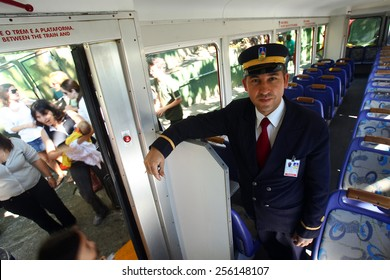 RIO DE JANEIRO, BRAZIL - APRIL 25, 2013: Corcovado Train conductor transporting tourists daily to the statue Christ the Redeemer.