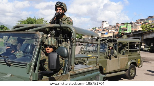 Rio de Janeiro, Brazil- April 05 2014- Brazilian soldiers patrols  the Mare shantytown in Rio. The operation, part of the preparations for the 2014 World Cup.ANTONIO SCORZA