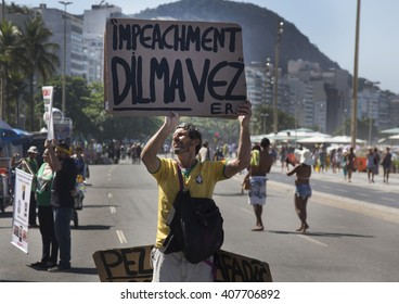 Rio de Janeiro, Brazil:  April/17th/2016 -  A  Brazil's President Dilma Rousseff opositor shows a banner during demonstration at Copacabana beach.