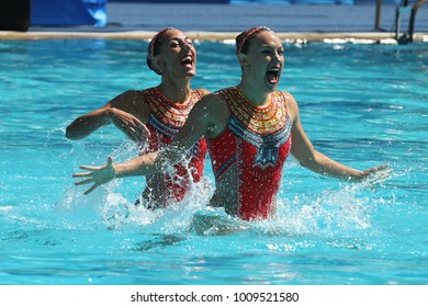 RIO DE JANEIRO, BRAZIL - AUGUST 14, 2016: Laura Auge and Margaux Chretien of France compete during the synchronized swimming duet free routine preliminary round at the 2016 Summer Olympics
