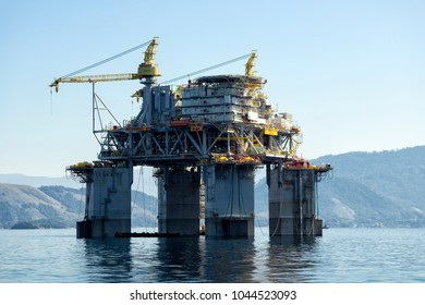 Rio de Janeiro, Brazil, August 4, 2013: Petrobras Petroleum Platform P61 TLWP (Tension Leg Wellhead Platform)  being transferred to the Campos production Field from the Angra bay.
