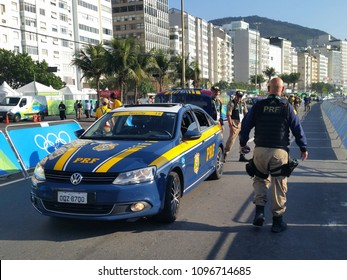 RIO DE JANEIRO, BRAZIL - AUGUST 6, 2016: The Brazilian Federal Highway Police provides security for Rio 2016 Olympic Cycling Men Road Race of the Rio 2016 Olympic Games in Rio de Janeiro