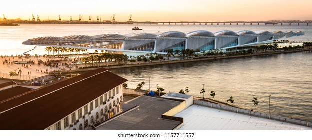 Rio de Janeiro, Brazil - August 11, 2018: View of Museum of Tomorrow, a futuristic science museum, designed by Santiago Calatrava, with Rio - Niteroi bridge in the Horizon, at sunset.