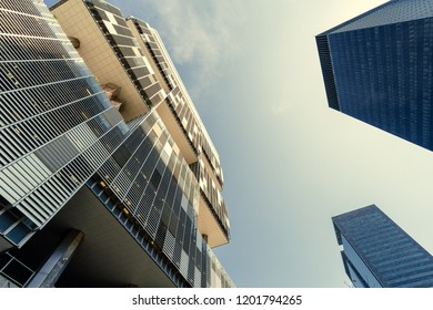 Rio de Janeiro, Brazil - August 21, 2018: Petrobras oil company headquarters building during dusk seen from below along with other office buildings