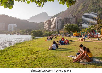 Rio de Janeiro, Brazil - August 11, 2019: people relaxing and spending time outdoors on a sunny Sunday afternoon at Lagoa Rodrigo de Freitas.