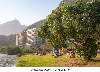 Rio de Janeiro, Brazil - August 11, 2019: people relaxing and spending time outdoors on a sunny Sunday afternoon at Lagoa Rodrigo de Freitas.