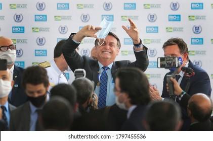 Rio de Janeiro, Brazil  August 14,  2020  Brazilian president jair Bolsonaro holds a mask as waves to the followers during a ceremony.