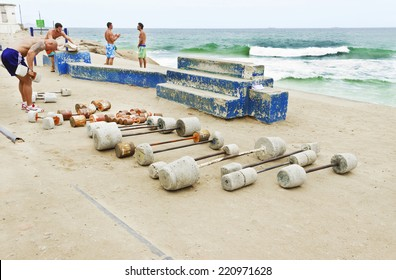 RIO DE JANEIRO - BRAZIL - August 18, 2014: Men in outdoor fitness Gym , popular Flinstones - Adventure rudimentary equipment - Devil's Beach Arpoador  Ipanema