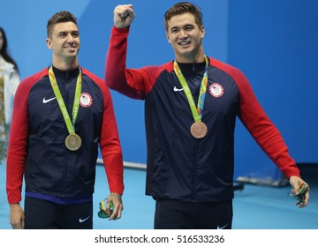 RIO DE JANEIRO, BRAZIL - AUGUST 12, 2016:Olympic Champion Anthony Ervin (L)  and bronze medalist Nathan Adrian of United States after medal ceremony after Men's 50m Freestyle of the Rio 2016 Olympics
