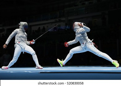 RIO DE JANEIRO, BRAZIL - AUGUST 13, 2016: Ibtihaj Muhammad of United States (R) and Sofya Velikaya of Russia compete in the Womenâ??s Sabre Team of the Rio 2016 Olympic Games at Carioca Arena 3