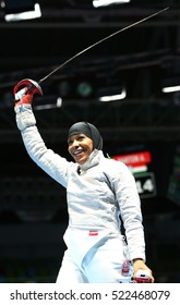 RIO DE JANEIRO, BRAZIL - AUGUST 8, 2016: Ibtihaj Muhammad of the United States celebrates victory in the Women's individual sabre match of the Rio 2016 Olympic Games at the Carioca Arena 3