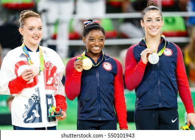 Rio de Janeiro, Brazil. August 16, 2016. ARTISTIC GYMNASTICS - WOMEN'S FLOOR EXERCISE FINAL at the 2016 Summer Olympic Games in Rio De Janeiro. Left Vanessa Ferrari, Simone Biles, Aly Raisman.