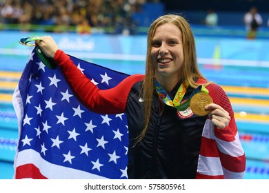 RIO DE JANEIRO, BRAZIL - AUGUST 8, 2016: Olympic Champion Lilly King of the United States celebrates victory after Women's 100m Breaststroke Final of the Rio 2016 Olympic Games