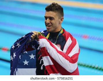 RIO DE JANEIRO, BRAZIL - AUGUST 12, 2016: Olympic Champion Anthony Ervin of United States during medal ceremony after Men's 50m Freestyle final of the Rio 2016 Olympics