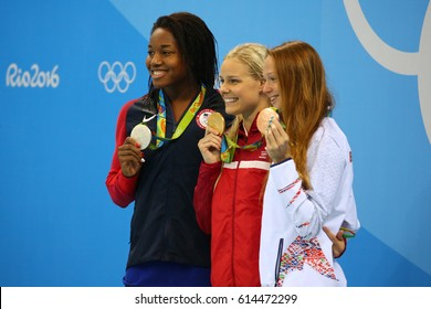 RIO DE JANEIRO, BRAZIL - AUGUST 13, 2016:Simone Manuel (L) USA, Pernille Blume Denmark and Aliaksandra Herasimenia BLR during medal ceremony after Women's 50 metre freestyle of the Rio 2016 Olympics