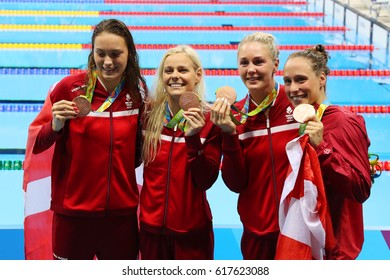 RIO DE JANEIRO, BRAZIL - AUGUST 13, 2016: Bronze medalists Team Denmark Women's 4 × 100m medley relay Mie Nielsen, Rikke Moller Pedersen, Jeanette Ottesen, Pernille Blume at the Rio 2016 Olympics